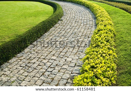 Stone walkway in garden - stock photo