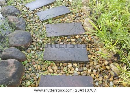 Stone walkway in the rock garden - stock photo
