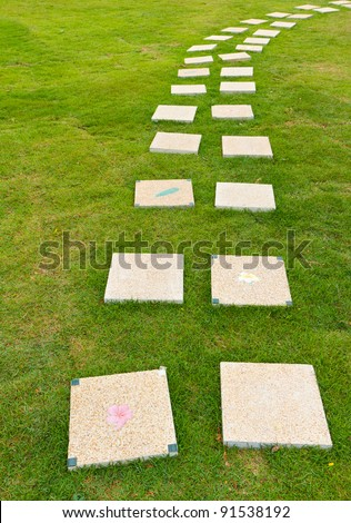 stone walkway on green grass - stock photo
