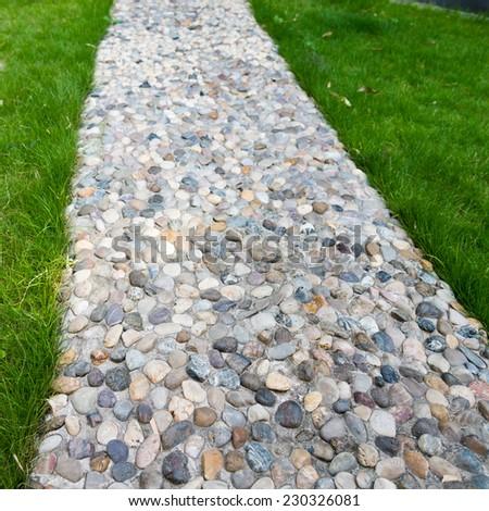 stone walkway through the garden - stock photo