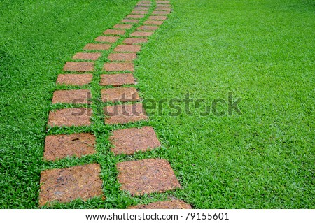Stone walkway winding in garden - stock photo