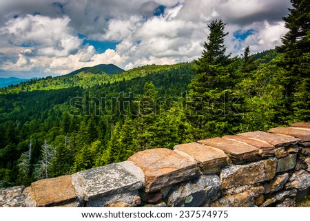 Stone wall and view of the Blue Ridge from Devils Courthouse, near the Blue Ridge Parkway in North Carolina. - stock photo
