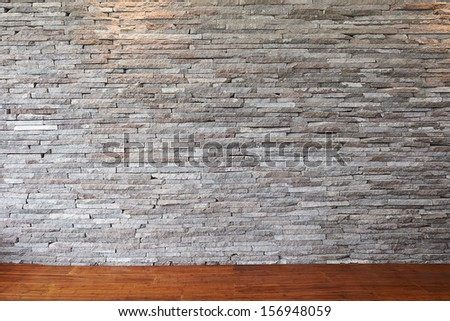 Stone wall and wooden floor - stock photo