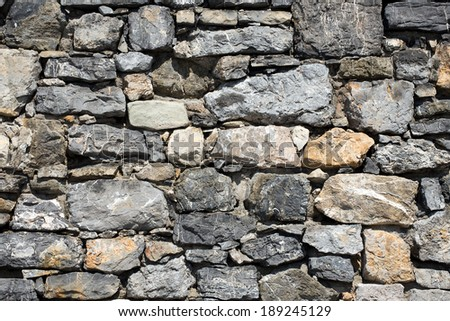 Stone Wall Background / An old gray and brown stone wall makes an excellent background - stock photo