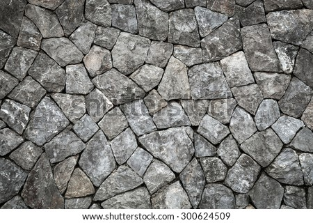 Stone wall background and texture with space - stock photo
