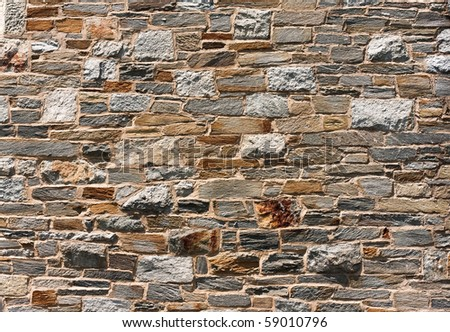 Stone wall background texture detail - stock photo