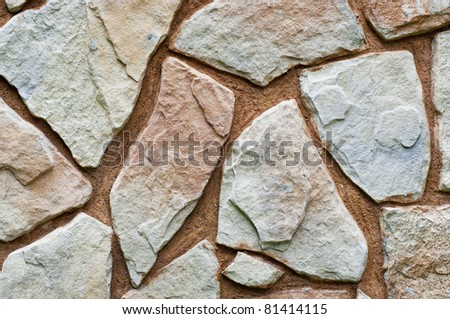 Stone wall background with odd shapes and sizes - stock photo