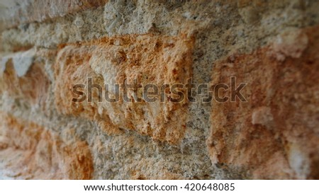 Stone wall decoration texture on modern building facade, artistic architecture pattern wallpaper background, close-up - stock photo