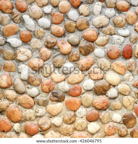 Stone wall decoration texture on modern building facade,  stone artistic architecture ,pattern of stone wallpaper background. - stock photo