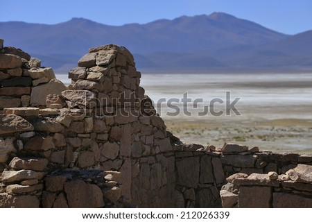 Stone wall in Altiplano high plateau at Andes Mountains, Bolivia - stock photo