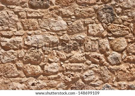 Stone wall in greek village on Crete island  - stock photo