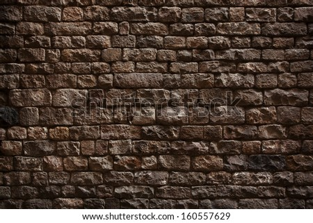 Stone wall made �¢??�¢??of rough bricks dark - stock photo
