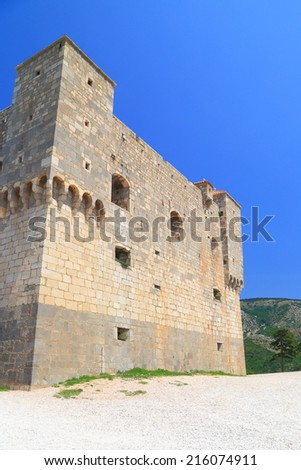 Stone wall of a fortress built on a hill top near Senj, Croatia - stock photo