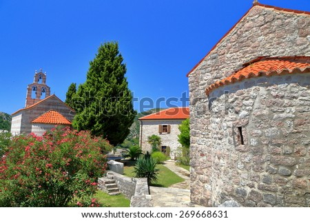 Stone wall of orthodox church in the Adriatic sea area, Montenegro - stock photo