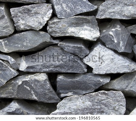 Stone wall of stone wall texture background - stock photo