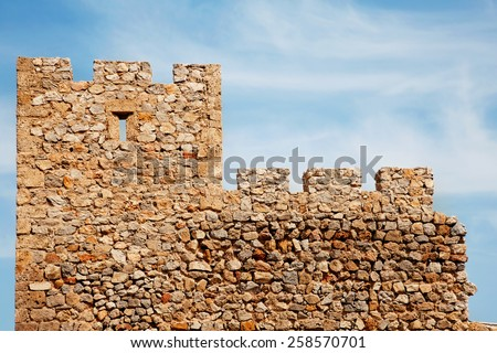 Stone wall of the old castle - stock photo