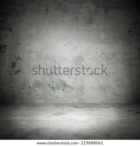 Stone wall on the street in shadow - stock photo