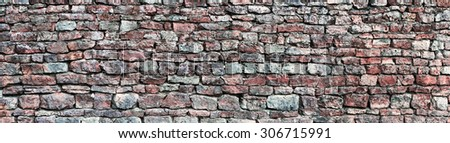 Stone wall panorama, panoramic stonewall pattern background, old aged weathered red grey grunge limestone dolomite slate slab rock texture, natural grungy, beige, yellow, gray brick vintage closeup
