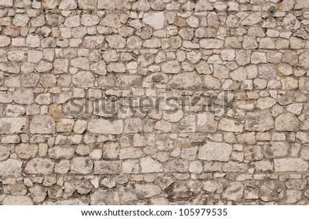 Stone wall protection, natural limestone as a background - stock photo