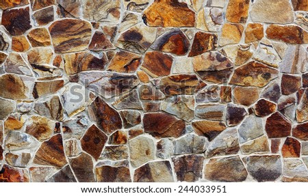 Stone wall texture built from colorful stones - stock photo