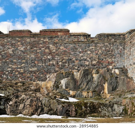Stone wall texture of Suomenlinna (Sveaborg) fortress, Finland. Panorama from 2 shots