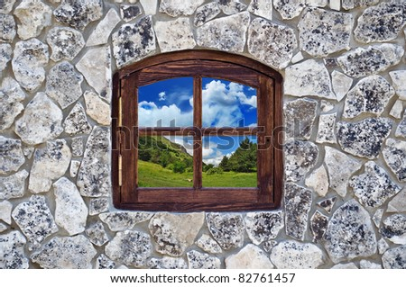stone wall with a window as an background - stock photo