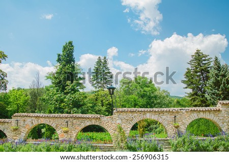 Stone Wall With Openings In The Form Of Arches - stock photo