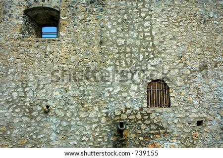 stone wall with window - stock photo
