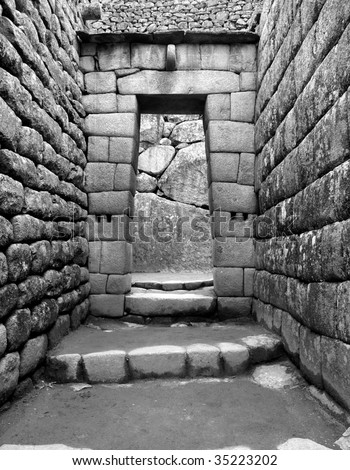 Stone walls and doorway in the ancient Inca city of Machu Picchu, Peru, South America. - stock photo