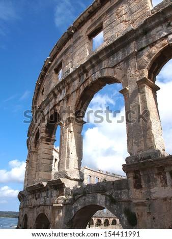 stone walls of old roman colosseum         - stock photo