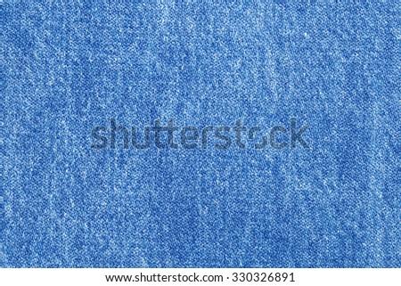 stone washed pale flat blue jeans fabric pattern background - stock photo
