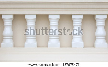 stone white balustrade with pillar on the wall