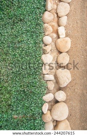 stone with green grass background - stock photo