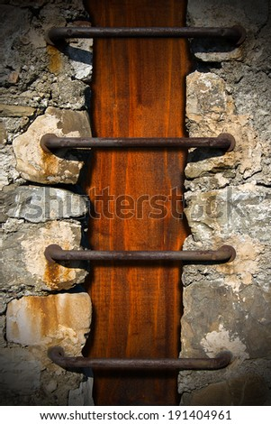 Stone Wood and Metal Grunge Background / Grunge background with stone wall, iron rusty bars and dark brown wood background - stock photo
