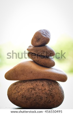 stone zen spa on wood with garden blurred - stock photo