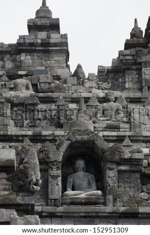 Stoned image of Buddha in Borobudur, Indonesia  - stock photo