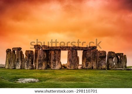 Stonehenge against fiery orange sunset sky - stock photo