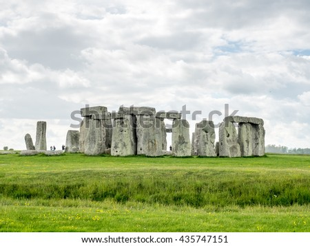 Stonehenge an ancient prehistoric stone monument near Salisbury, Wiltshire, England, with unrecognized tourist nearby. Stonehenge is the UNESCO World Heritage Site in England.