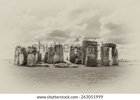 Stonehenge - an ancient prehistoric stone monument near Salisbury, Wiltshire, UK. It was built anywhere from 3000 BC to 2000 BC. Stonehenge is a UNESCO World Heritage Site in England. Antique vintage. - stock photo