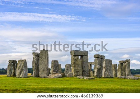 Stonehenge an ancient prehistoric stone monument under blue sky near Salisbury, Wiltshire - UK