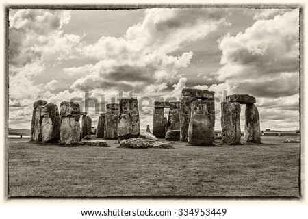 Stonehenge - ancient prehistoric stone monument near Salisbury, Wiltshire, UK. It was built anywhere from 3000 BC to 2000 BC. Stonehenge is a UNESCO World Heritage Site in England. Ancient photo style - stock photo