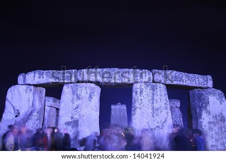 Stonehenge at Night on the Summer Solstice with Worshipers - stock photo