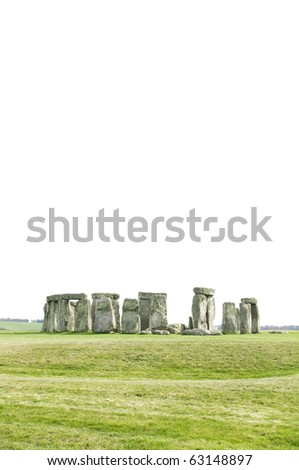 Stonehenge historic site on green grass under blue sky, isolated on white background - stock photo