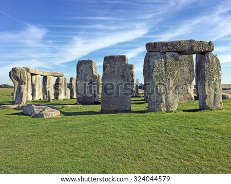 Stonehenge in England, is a major tourist attraction, drawing people from all over the world to see it. - stock photo