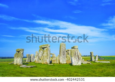 Stonehenge in Wiltshire in the UK in cloudy weather. It is a prehistoric monument 8 miles north from Salisbury, in the place called Wiltshire in South West England. It is under protection of UNESCO. - stock photo