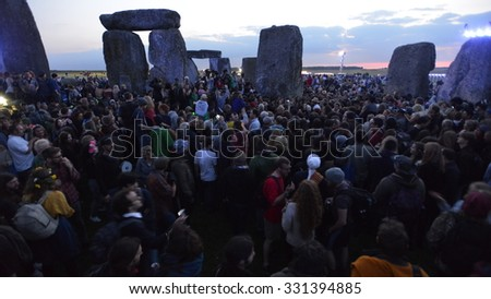 STONEHENGE - JUNE 21: A druid joins celebrations marking the Summer Solstice on Jun 21, 2014 in Stonehenge, UK. Thousands gathered at the ancient historic monument to celebrate the solstice. - stock photo