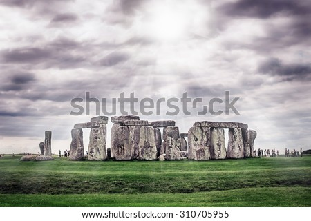 Stonehenge, prehistoric monument located in Wiltshire, England, UK. Image with selective focus, toning and effects of shining sun rays.