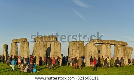 STONEHENGE - SEP 23: Pagans and druids celebrate the autumn equinox at the ancient standing stones on Sep 23, 2015 in Stonehenge, UK. The world famous landmark is thought to date back to 2600 BC. - stock photo
