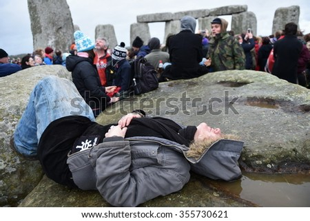 STONEHENGE, UK - DEC 22, 2015: Pagans, druids and revelers celebrate the winter solstice at the ancient standing stones. Several thousand revelers marked the event at the world famous landmark.