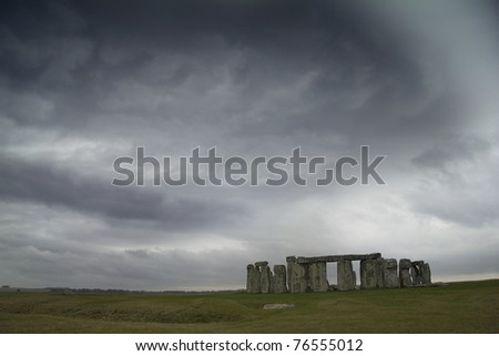 Stonehenge under moody sky - stock photo